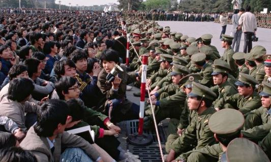 Soldiers face to face with student demonstrators during 1989's Tiananmen Square protests
